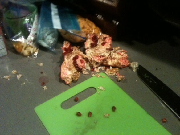 I came home to this yesterday. It looks like my wife murdered an alien in our kitchen. It used to be a pomegranate.