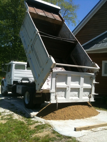 Sand and gravel delivery came in one partitioned truck.