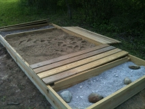 The completed sand box with #10 gravel in the foreground.