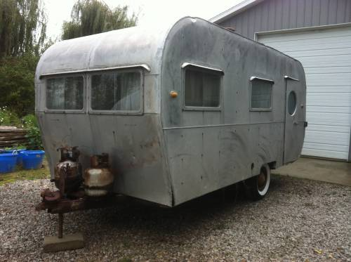 This two door 1953 canned ham style trailer would be perfect. I love the port hole window in the door. Asking price is right in our budget at $1,600