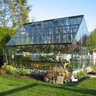 An awesome greenhouse from Greenhouse Megastore online. Great style.