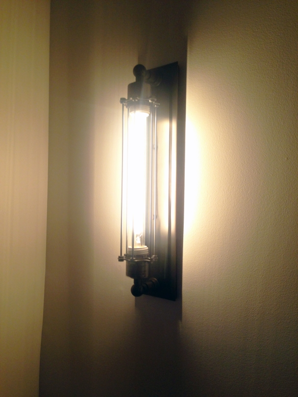 The caged wall sconce we bought from Restoration Hardware.